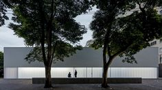 Polycarbonate panels run along the base of this gallery in São Paulo by architects Metro, flooding the space with natural light