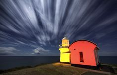 clouds move in a moonlit sky over three minutes while I lightpaint the lighthouse with flashes and coloured gels