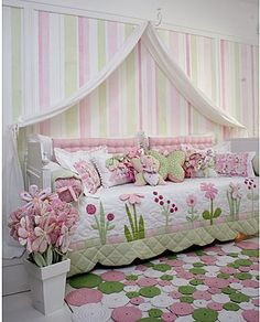 Day bed flower garden bedroom in pink, green and white. Just lovely! This pink, green and white palette is perfect for a little princess room. A daybed can be used as seating as well .especially in a sunroom with this quilt on it. Delightful pink and gree