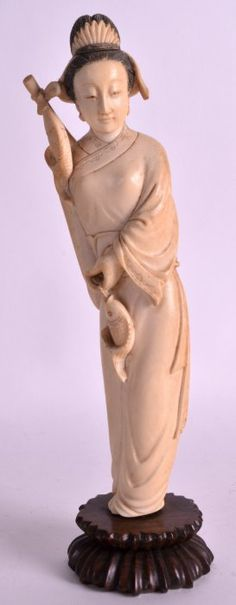 An Early 20th Century Chinese Carved Ivory Figure Of