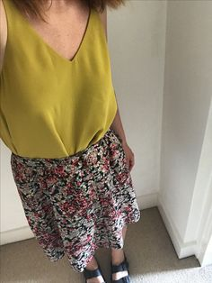 Summer outfit essentials. Mustard cami and floral midi skirt
