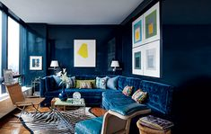 Lacquered walls and a custom-made St. Thomas–style sofa upholstered in a velvet set a glamorous tone.  A wicker Sled chair and prints provide lively counterpoints.