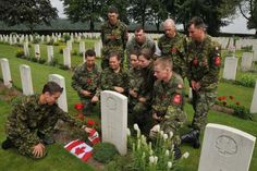 The Nijmegen Canadian Contingent attends a remembrance service at the Groesbeek Canadian War Cemetery during day 3 of the International Four Days Marches in Nijmegen, the Netherlands.