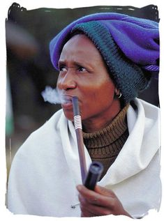 Xhosa lady enjoying her pipe at the lesedi cultural village -South Africa South Africa Tours, East Africa, African Traditional Wear, Xhosa, African Wedding Dress, Cultural Identity, African Tribes, African Culture, Black People