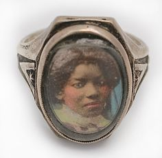 Victorian sterling silver hand tinted photo ring of a young black woman, ca.1880. Token of love or Momento Mori? Who knows?  But it certainly is very cool.