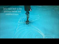 How to Longarm Quilt A Feathered Swirl Fill - YouTube