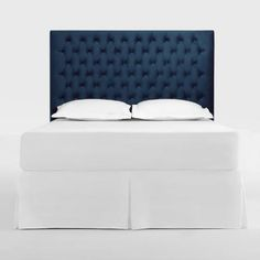Elevate your bedroom decor with our chic blue headboard featuring diamond tufting and smooth velvet-like upholstery for a sophisticated edge.