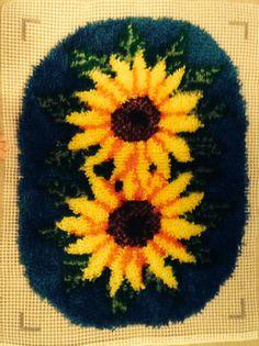 Sunflower Latch Hook Rug by MadiesKnits on Etsy https://www.etsy.com/listing/204051213/sunflower-latch-hook-rug