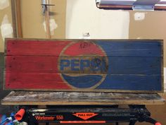 Antique Pepsi sign created with pallet wood. Graphic made using contact paper and a print-out.
