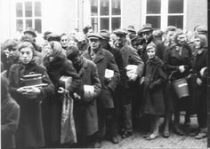1944 - 1945. People in line at a soup kitchen in Amsterdam. During the Winter of 1944-1945 Dutch rail workers went on strike to stop the Germans, who then punished them by putting a hold on all maritime transport. This cut off all food and fuel delivery. More than 20,000 people lost their lives in Amsterdam and the western part of the Netherlands during the winter of 1944-1945. #amsterdam #wordwar2 #hongerwinter