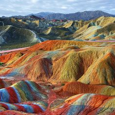 No, this isn't a painting stolen from a Holiday Inn and you're not having some kind of extra-vivid fever dream. These incredible images are actual views of a danxia formation in a mountain range in southeast China.