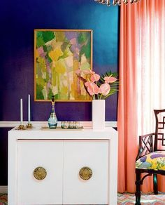 color scheme: prussian blue, bright artwork, white trimming #anthurium in the room