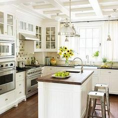 BHG - kitchens - white, box beams, beadboard, ceiling, cafe, curtains, farmhouse, sink, off-white, kitchen cabinets, glossy, polished, black, granite, countertops, sink in kitchen island, off-white, beadboard, kitchen island, butcher block, countertop, pot filler, cafe curtains kitchen, kitchen cafe curtains, coffered ceiling,