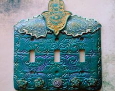 Light up your home with this attractive blue hamsa switch plate