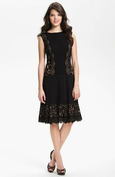 Tadashi Shoji Lace Paneled Drop Waist Dress GBP 245.06   Scalloped lace panels frame the sides of a finely pleated bodice and trim the flared hem of a drop-waist dress, accentuating the vintage-inspired silhouette.