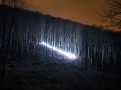 For his 2014 series New Moon, photographer David Lados captured varying streaks of light slicing through remote areas of Hungarian forests, many specifically staged throughout the Mátra mountain range. Landscape Photography Tips, Landscape Photographers, Landscape Photos, Photography Ideas, Into The Woods, Urban Landscape, Abstract Landscape, Collections Photography, Colossal Art