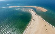The new island off North Carolina's coast has captivated attention from Asia to the United Kingdom, but who really owns it? Why..Dare County of course