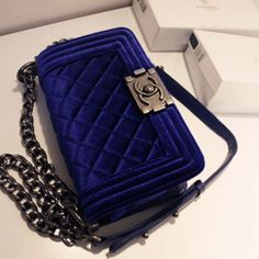 Chanel blue velvet. OH HELL YES ! I must have this. It matches my hair so it belongs with me!