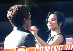 In this 'Behind The Scenes' photo of Catching Fire, Jennifer puts makeup on Josh. Ha.