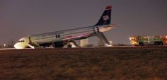 A U.S. Airways plane with a collapsed nose is seen at Philadelphia International Airport March 13, 2014. REUTERS/Tom Mihalek
