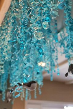 Curling ribbon hanging from ceiling with sequin whale and fish ornaments would be a great part of an under the sea or mermaid party. Mermaid Under The Sea, Under The Sea Theme, Under The Sea Party, The Little Mermaid, Little Mermaid Birthday, Little Mermaid Parties, First Birthday Parties, First Birthdays, Birthday Ideas