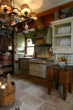 Farmhouse Kitchen that is anything but quaint.  Very modern appliances and all the comforts of a professional kitchen set up.