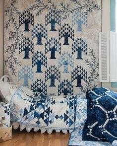 Edyta Sitar of Laundry Basket Quilts uses a lot of half-triangle squares – the quilt on the wall is Blue Spruce and the one on the bed is Frost. Both are made with Cold Spell Prints & Batiks. Two Color Quilts, Blue Quilts, White Quilts, Laundry Basket Quilts, Laundry Baskets, Quilt Border, Tree Quilt, Traditional Quilts, Applique Quilts