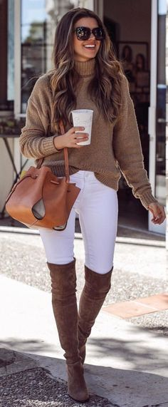 #spring #outfits woman wearing grey sweater, white jeans, and cowboy boots during daytime. Pic by @thecharmingolive