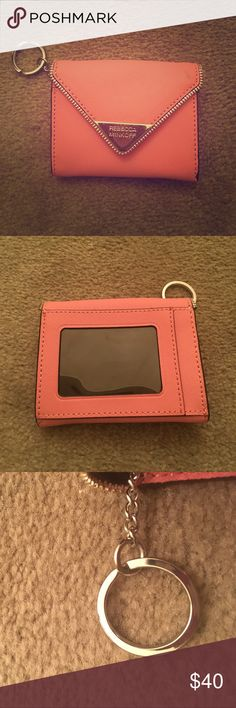 Rebecca Minkoff wallet (light pink) Rebecca Minkoff wallet with a clear viewing back!  Brand new, never has been used.  Please note there is a small grey scuff on the right side.  Want to sell soon, please send me your best offer Rebecca Minkoff Bags Wallets