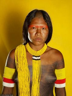 South America | Portrait of young Kayapo woman with traditional body paintings wearing beaded jewelry, Brazil | © Jaime Ocampo Rangel #beads #tattoo