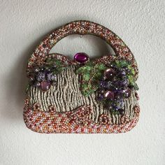 Mary Francis beaded bag. This darling evening bag is covered in natural stones and beads. It is diminutive in size but hard sided. It will hold credit card case cigarettes lighter lipstick compact and keys.  No beads missing and it has the Mary Francis tag. Mary Francis Bags Satchels