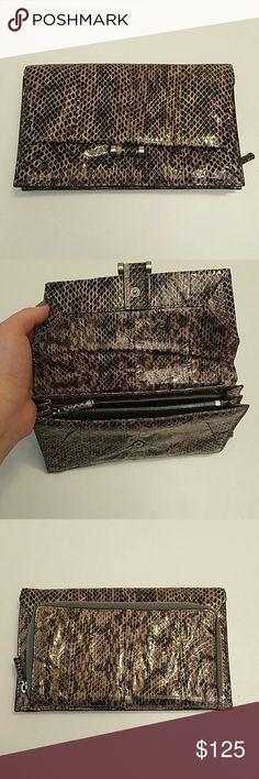 Selling this Gray Watersnake clutch on Poshmark! My username is: fancyballer. #shopmycloset #poshmark #fashion #shopping #style #forsale #Calvin Klein #Handbags