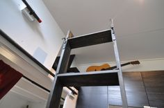 loft stairs for tiny houses -- Buy a wood attic ladder. Make sure that when extended the length is long enough to meet your own loft needs. For us in hOMe, just the smallest ladder was more than enough. Lofted Dorm Beds, Bunk Bed Ladder, Loft Bed Frame, Attic Ladder, Loft Beds, Tiny House Stairs, Tiny House Loft, Tiny House Plans, Loft Stairs