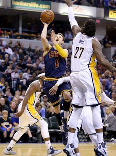 617bf1e89 Matthew Dellavedova Photos - Matthew Dellavedova  8 of the Cleveland  Cavaliers shoots the ball during