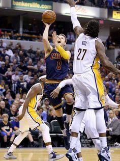 be38d574b63f Matthew Dellavedova Photos - Matthew Dellavedova  8 of the Cleveland  Cavaliers shoots the ball during