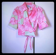 Lilly Pulitzer wrap blouse Beautiful colors! Cuffed sleeve. Size 2. Mint condition. Plus use the offer button to negotiate price. No trades. Lilly Pulitzer Tops Blouses
