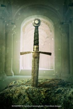 Sandra Cunningham MEDIEVAL SWORD IN STONE INSIDE CHURCH Miscellaneous Objects