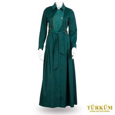 This bottle green abaya is a mix of contradictions. With a collar that is a lighter shade of the same bottle green, and a belt that is of the darker shade, this piece of clothing is darkly elegant. The front of the abaya is adorned by a brown, wood-like button, and two brown buckles to let the belt pass through