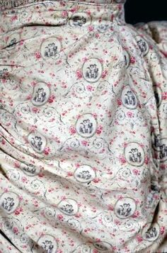 Fabric Close Up, 1878-1880 Printed Cotton Sateen Seaside Dress, Fabric printed with pink roses and cupids.