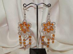 boucles d'oreilles étoiles perles de verre couleur topaze et argentées €5