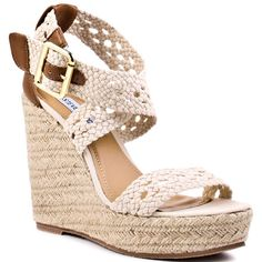 You'll be referred to as royalty when the Magestee is added to your favorite outfit.  Steve Madden features crocheted straps in a sweet summery beige color and adjustable closure.  A raffia wrapped 4 1/2 inch wedge and 1 1/4 inch platform will keep you the fashion ruler in your circle. - HighOnShoes.com