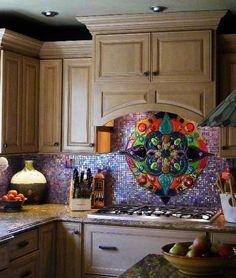 Absolutely stunning fused glass design over stove plus colorful tile backsplash