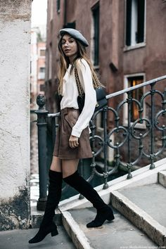 white blouse, leather high waist skirt, over the knee boots