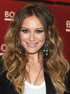 """""""A center part on hair that's shoulder-length or longer is nice against an oval backdrop,"""" says Gibson. To avoid looking too severe, add some soft waves, like Hilary Duff's, with a beach-hair-mimicking spray like Fekkai Coiff Oceanique Tousled Wave Spray. If you want a bit more texture, wrap random sections around a large-barrel curling iron. """"The effect is incredibly romantic,"""" he adds."""