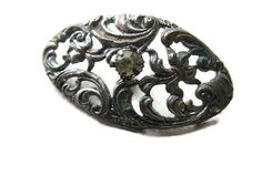 old Victorian oval-shaped filigree button with rhinestone