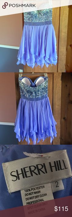 Sherri Hill dress Beautiful periwinkle Sherri Hill dress.  My daughter wore one time for her senior homecoming.  Pictures don't do it justice.  Has bra cups already sewn in top of dress. Sherri Hill Dresses Strapless