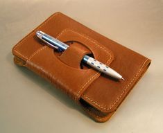 Using the pen as a closure on a pocket notebook - cool!
