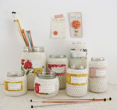 "via Dottie Angel (flickr) ""Little jars in woolly jackets perfectly suited for holding knitting needles, high hopes, crochet hooks, pens, pencils, thumb tacks, makeup brushes, small posies of flowers, crappity crap"