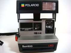 My mister's Christmas gift!! Throwback-love the 80's Polaroid!