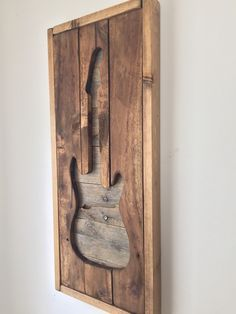 A personal favorite from my Etsy shop https://www.etsy.com/listing/234527579/rustic-wall-decor-electirc-guitar